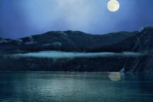 full moon over a shore in Alaska