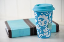 blue coffee cup and Bible