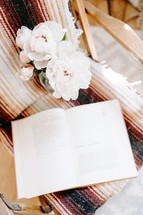 peonies and book in a chair