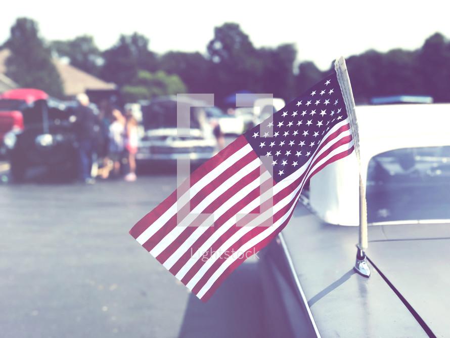 American flag on a car antenna