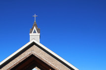 a church steeple against a cobalt blue sky