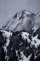 snow on misty mountain peaks