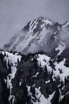 snow on misty mountain peaks