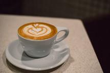heart shape creamer design in coffee cup