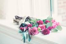 bouquet of roses in a window sill