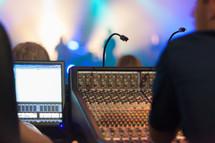 man at a sound board