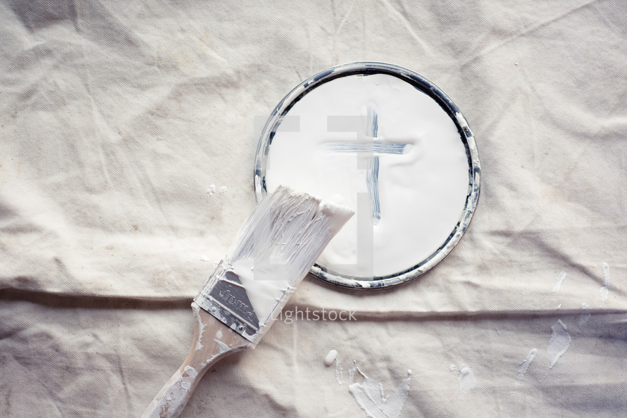 paint brush and paint lid with cross