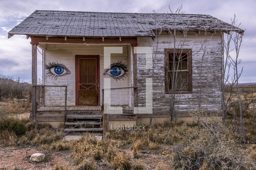 eyes painted on an abandoned house