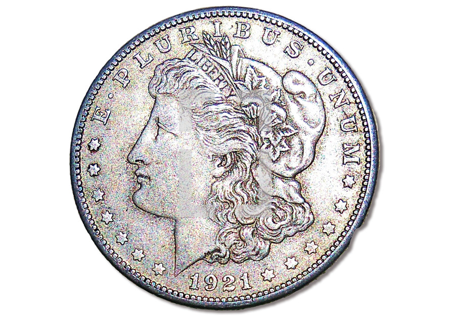 A 1921 Morgan Silver Dollar minted in 1921. It is rare to find these silver coins except among collectors but silver and gold are the currency that we set our currency standard that we use for exchange currency, savings and buying power  in today's economy. Silver and Gold were often mentioned in the bible as currency and things of lasting value from biblical times to today's marketplace.