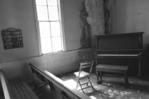 piano in a corner of an old church
