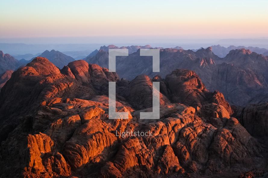 A sunrise shines on the mountains around Mount Sinai, Egypt.