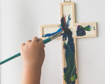 a child painting a cross