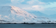 The mountain of Kistufell in the Esja range, across the bay from Reykjavik, catching the light of the rising sun