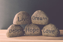 stones with the words live, love, dream, hope, and believe