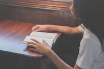 teen girl reading a Bible