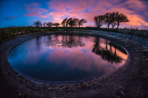 puddle and purple sky at sunset