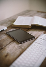 Using tablet together with bible and writing at the computer