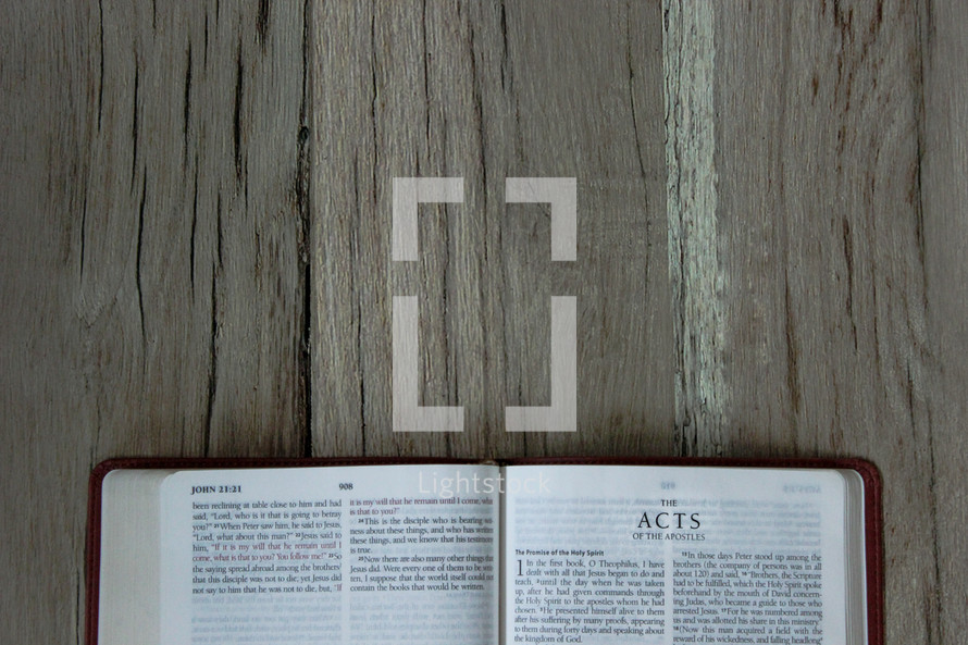 A Bible opened to Acts