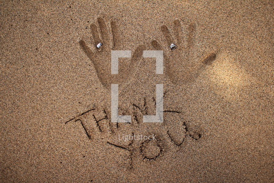 hand prints in the sand - Thank You