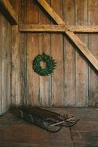 wood sled and wreath