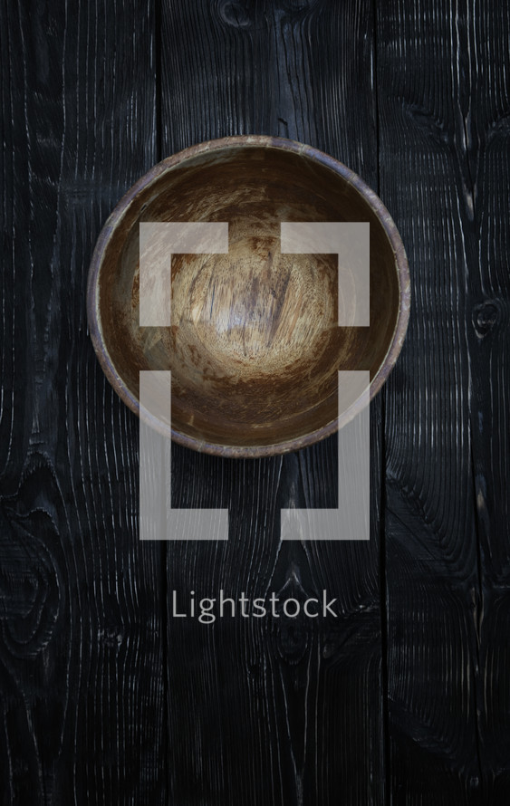 a wood bowl on wood boards