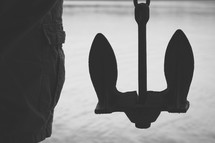 silhouette of a man and an anchor