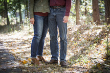 legs of a husband and wife in fall