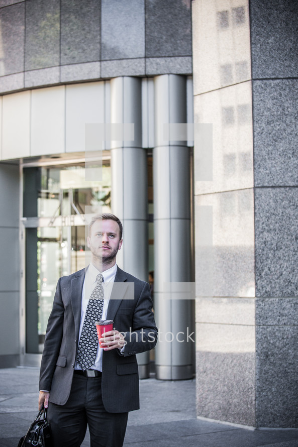 portrait of a businessman with coffee cup and briefcase