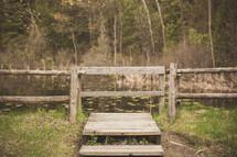a fence along a pond
