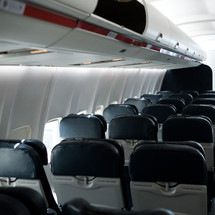 rows of empty seats on an airplane