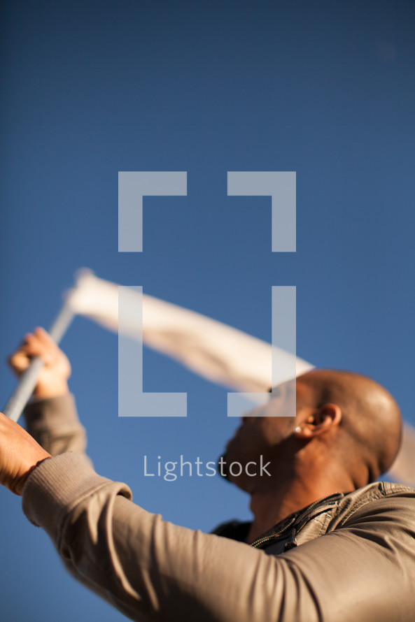 Man waving white flag.