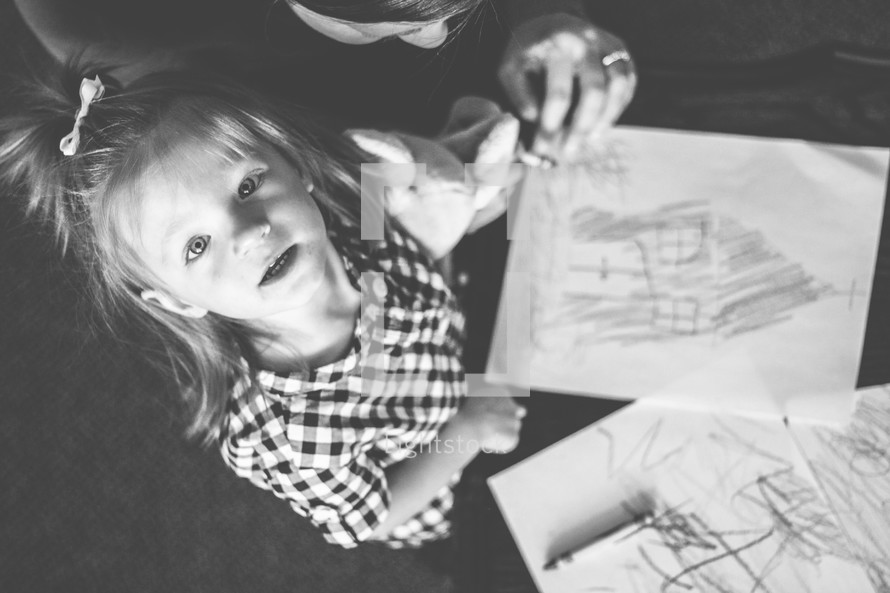 toddler girl coloring with crayons