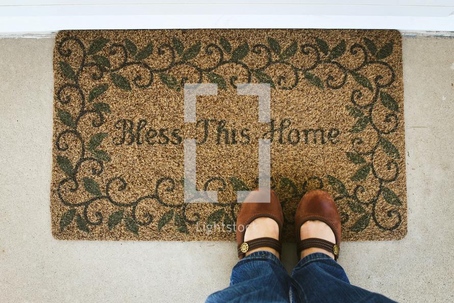 woman standing on a door mat
