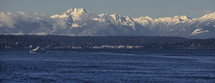 The snow covered Olympic mountains on a spring day.