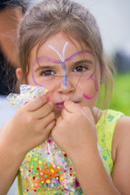 a girl child with face paint