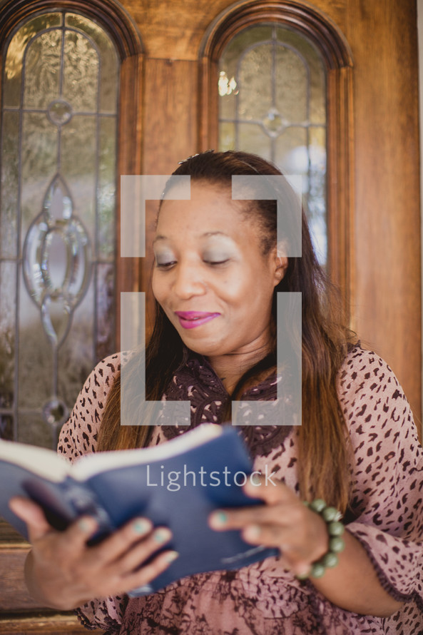 African American woman reading from a Bible