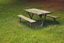 picnic table in grass