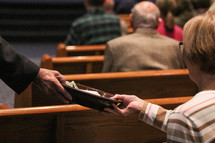 passing a collection tray during a church service