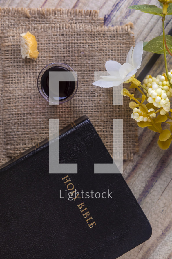 communion elements on burlap and Holy Bible