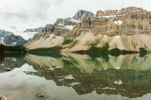 reflection of mountain peaks in lake water