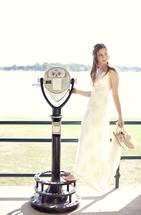 Bride standing in front of binoculars