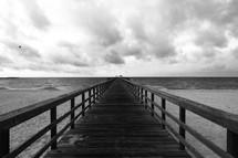 Boardwalk over beach water