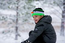 boy child in a winter snowsuit