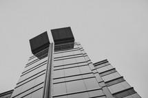 A glass building reaches into the sky