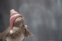 bird figurine in a winter hat