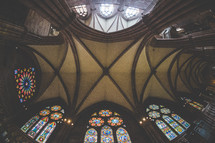 ceiling and stained glass windows in a cathedral