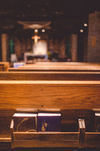 hymnals and books of worship in pews