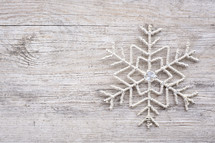 snowflake decoration on wood background