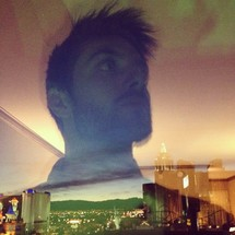 double exposure of a man and cityscape