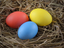 Three Easter eggs in a nest